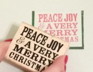 STEP 2 - Stamp a Christmas sentiment on a square piece of cardstock. Border with contrasting color.